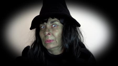 büyücü : Spooky Halloween witch making a mean face Stok Video