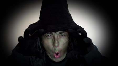büyücü : Spooky Halloween witch making a mean face and casting spells Stok Video