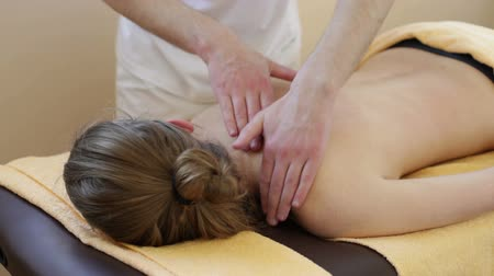 acupressure : Massage. Manual therapist manipulates on womans shoulder, close up