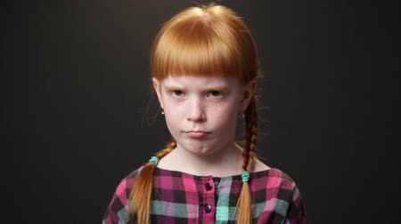 aggrieved : Close up sad ginger girl