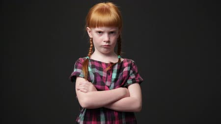 discontentment : Sad ginger girl, she is looking displeased and offended