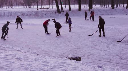 MINSK, BELARUS - JAN 23, 2018: Street team is playing ice hockey on a frozen pond in a city park