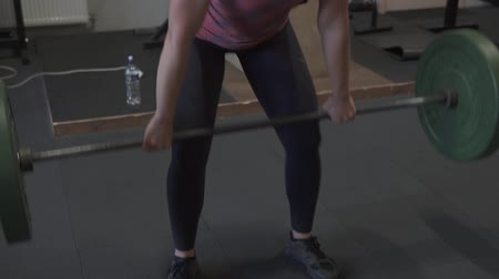tornaterem : Fitness woman doing barbell clean and jerk workout in gym