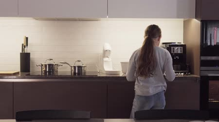 mixer : Little girl is stirring something in bowl while cooking Stock Footage