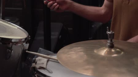 Man jazz drummer play drums during music show