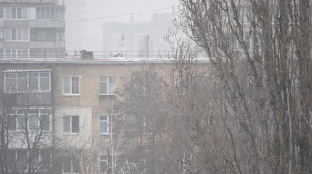 housing problems : Fine snow falling on background of apartment blocks