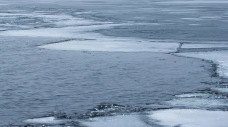 wavelet : Timelapse of water waves on partly frozen lake with blocks of ice