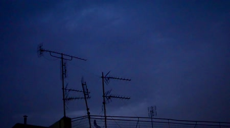 feiúra : The Perfect Storm; spectacular thunderbolts and lightnings. Thunderbolts & lightnings in a summer night over building top TV antennas