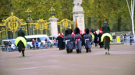 buckingham palace : Marching bands at ceremony of Changing the guards at Buckingham palace in London Stock Footage