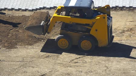 alabama : Construction Site - Stock Video. Gravel and dirt being moved around on a construction site by a frontend loader. Stock Footage