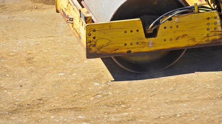 levelling : Heavy Steamroller  Roadroller - Stock Video. Ground level shot of a roller levelling the ground Stock Footage