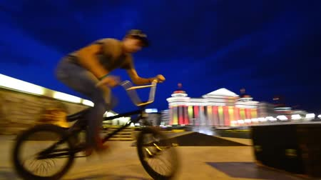 exiting : young extreme biker rides on box ramp in Skopje, Macedonia