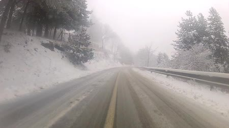 point of view pov : Driving in the winter fog covered mountain asphalt road - Stock Video Stock Footage