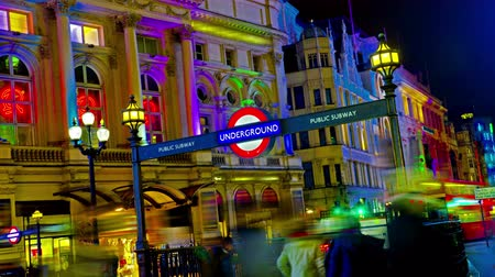 londra : 4K Amazing London Picadilly circus underground sign Quad Ultra HD hyper time lapse. Timelapse movie of the bright lights of Piccadilly Circus in London, at night