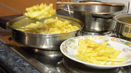 triglycerides : French Fries. Chips frying in a oil pan. Boiling in oil.