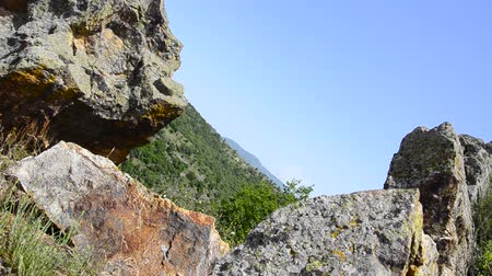 metamorphic : huge iron and bronze mine rocks stones in nature on the high altitude mountain with bright blue sky, dolly shoot.