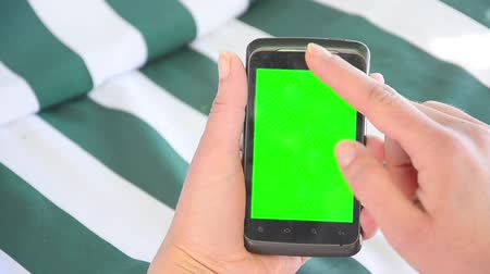 clique : Hands on a smart phone CHROMA KEY, Fingers gestures typing on a smart phone.