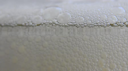 cerveja : Beer Detergent Wine Champagne Foam rising - HD, HD 1080i macro shot of beer foam in a glass. More beer is poured and the foam rises.