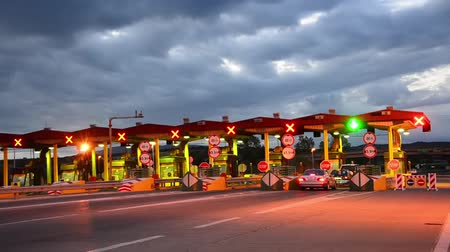 плата : Highway Car Paytoll at sunrise, Night lights and Autos passing through toll booths, pay for using highway and motorway
