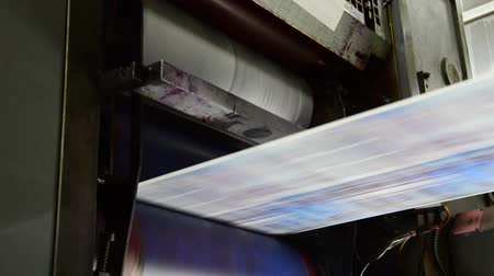 print shop : Webset offset print shop newspapers Printing (Loop), Newspapers coming off the rotation printing press industrial machine. Seamless looping video. Stock Footage