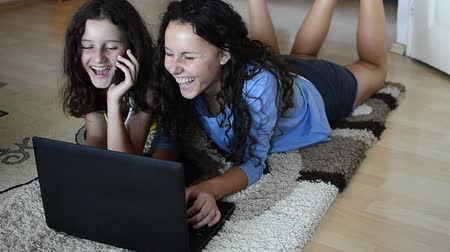 girl : Wireless Technology, Two sister girls use laptop laying, having fun and joy for finishing successful project