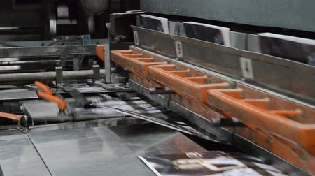 print shop : book and magazine perfect bound production line. Cover is assembled (glued) with the rest of the magazine