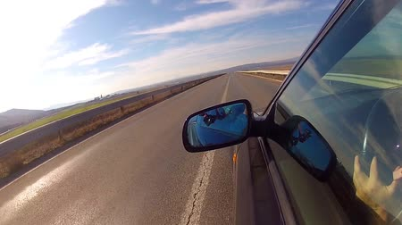 bok : Sport car driving, mirror reflection. Hood side reference. Mounted camera, front view. Black car ride. Country road highway. Bright blue sky, day. Fast Speed  Time-Lapse. HD. Dostupné videozáznamy