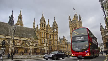 london england : London trafic near Big Ben and House of Parlament in London.A landmark of London