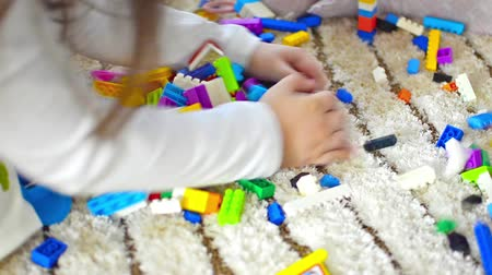 bloklar : Kindergarten child  girl playing with blocks toy
