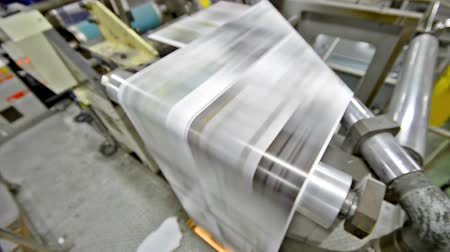 print shop : News print factory - Stock Video. Newspapers being carried to folding and stitching Stock Footage