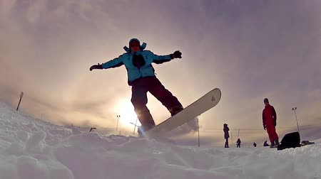 snowboard : Snowboarding jump on fresh sunset snow