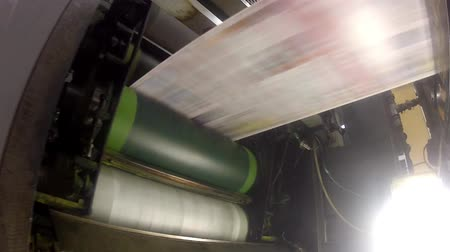 print shop : Rollers view. Print press roll paper goes through the rollers for newspaper printing webset production line.