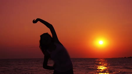 good : silhouette of teen exercising in sunset part II of II