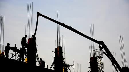 steel : Building Under Construction. Post concrete filling at high skyscraper Stock Footage