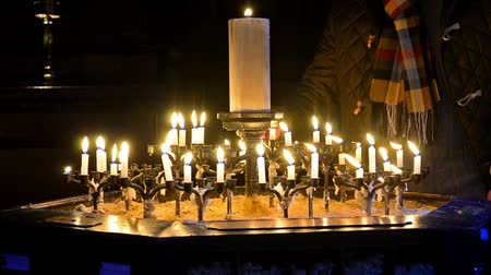 carrancudo : Prayer is igniting candle - Stock Video.  Inside of St. Paul Cathedral with candlelight, London, England