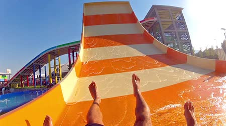 slayt : Sliding down on water slide in waterpark
