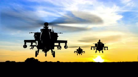 military tank : missile attack at sunset horizon by Apache Ah-64 Gunship Helicopters Stock Footage