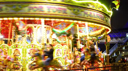 yuvarlak : Merry-go-round carousel at night in London, UK