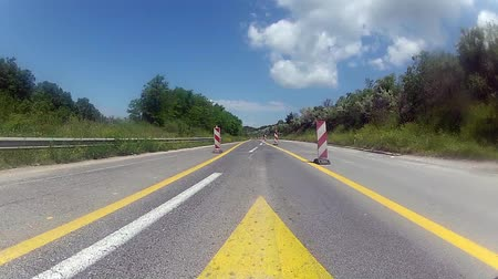 high speed road : Driving a Car on a Country Road timelapse - POV - Point of view frontn day. Construction work on the road