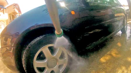 lavagem : Car Pressure Jet Washing POV. Worker washing car. Manual car washing cleaning with foam and pressured water at service station.
