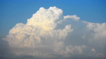mass start : Beautiful cloudscape with large, building clouds mass.
