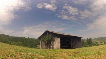 istálló : 4K  old wooden shed in the country, establishing shoot, timelapse