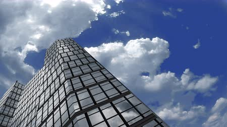glass building : 4k Low angle timelapse, wide field shot skyscraper building with fluffy timelapse of white clouds reflect in the steel and glass.