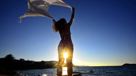 başörtüsü : Beautiful young woman on the beach AT sunset with a colored tissue scarf, FREEDOM CONCEPT