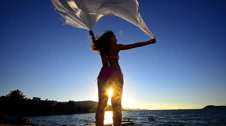 başörtüsü : silhouette of dancing woman sith scarf on the beach wind, inspiration,FREEDOM CONCEPT