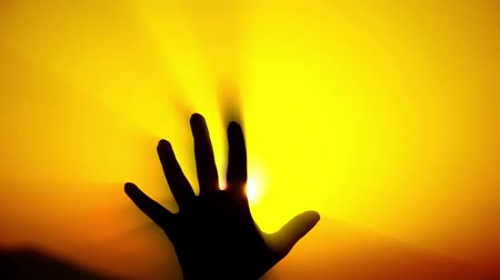inspiradora : DAY TO NIGHT CONCEPT, the hand catches the sun rays in a fist and makes darkness Stock Footage