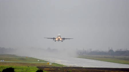 alma : Jet plane taking off at wet rain runaway
