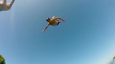 jump : High Water Jumping Backflip, Slow Motion Stock Footage