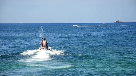 pwc : Sport drive on sea JET SKI. Friends do jet ski ride on open sea, look from behind