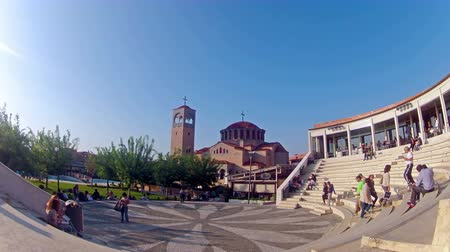 quad hd : Timelapse of commuters shopping. at Thessaloniki Mediterranean Cosmos mall taking break and meal at amphitheater stairs in Thessaloniki, Greece.